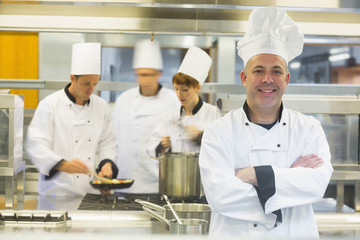 Mature male chef posing with crossed arms