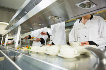 Four chefs working in a kitchen
