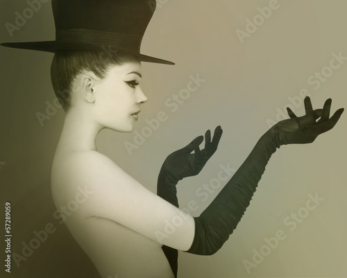 Elegant lady with hat and gloves.