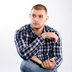 thoughtful man wearing checkered shirt