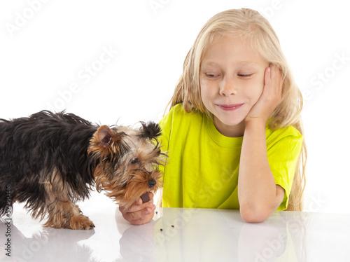 Little cute girl feeding her dog