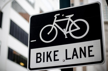 bike lane sign on the road