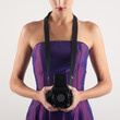 Elegant woman with medium format camera against white background