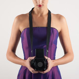 Elegant woman with medium format camera against white background