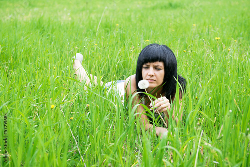 the girl lies on a grass