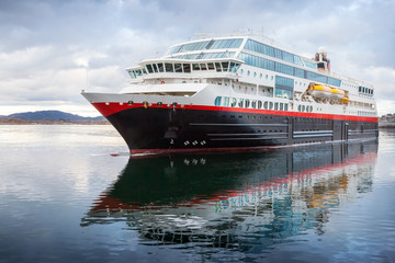 Big passenger cruise ship sails in Norwegian fjord