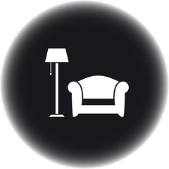 black round icon with floor lamp and armchair