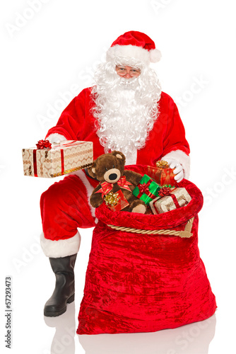 Santa handing out gifts isolated
