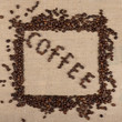 """Coffee"" word made of coffee beans with a frame of beans"