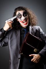 Joker with gun and briefcase