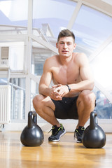 Man in a gym with dumbbells