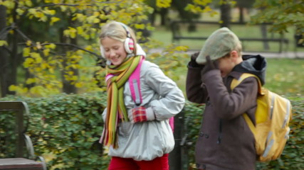 Two kids walking and talking while passing by their parents