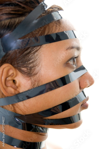 woman has a bandaged face with black tape..
