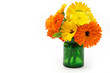 Marigold flowers bouquet in  green glass