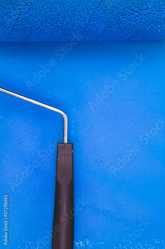 Blue paint roller handle on a background