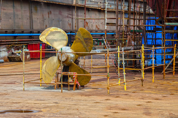 The propeller of a vessel in a dry dock.