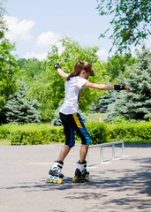 Young girl skating on rollerblades