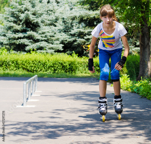 Young teenage girl practising her roller skating