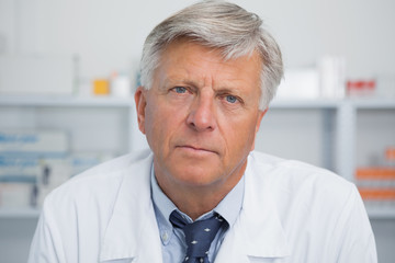 Serious doctor in pharmacy