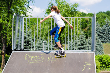 Young teeange girl on a ramp at a skate park
