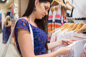 Woman looking at price tag