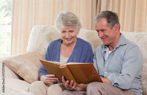 Seniors looking at their photo album