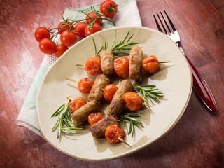 skewer with sausage and cherry tomatoes