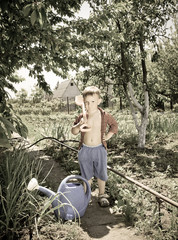 Adorable confident little boy gardening