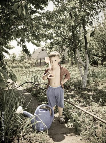 Adorable confident little boy gardening