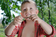 Little boy with an earthworm in his hands