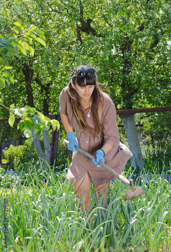 Attractive women working in the veggie garden