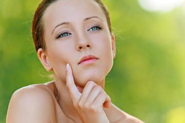 Portrait of pretty pensive young woman