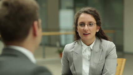 Businessman interviewing young woman in the office
