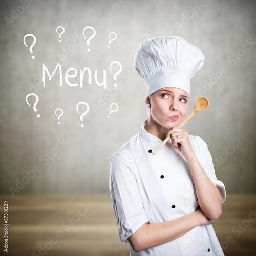 Leinwanddruck Bild junge Köchin denkt über ein Menu nach