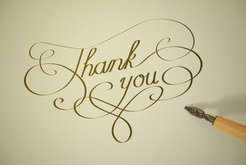 THANK YOU written in gold ink (calligraphy very much thanks)