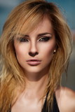 beautiful blond model with bright makeup with jewelery