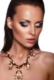 beautiful brunette model with bright makeup with jewelery