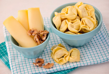 Bowl of tortellini homemade with cheese and walnuts