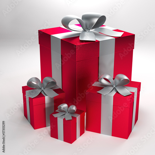 four red gift boxes with silver ribbons and bows with path
