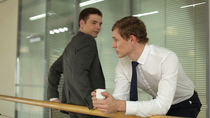 Two businessmen speaking during coffee break