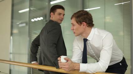 Two businessmen speaking during coffee break