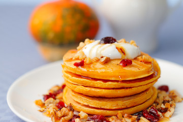 Pumpkin pancakes with walnuts and cranberries