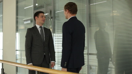Two businessmen meeting and talking