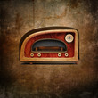 retro styled radio over grunge background