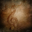 Treble clef retro styled grunge background