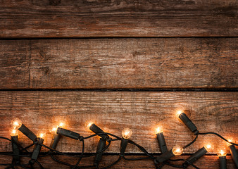Christmas rustic background - vintage wood with lights