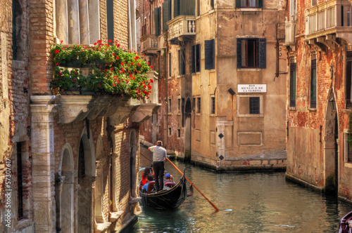 Venice, Italy. Gondola on a romantic canal.   - 57307617