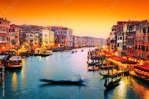 Venice, Italy. Gondola floats on Grand Canal at sunset