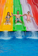 Father with daughters on tropical slide