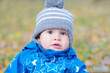 portrait of lovely baby boy in autumn outdoors